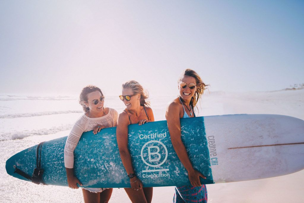 Business team with b corporation surfboard